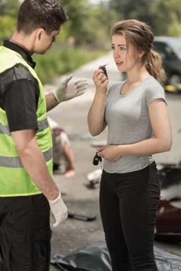 Woman Taking a Breathalyzer Test